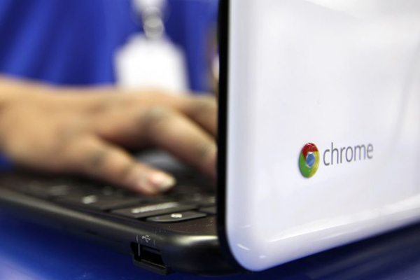 An employee demonstrates a Samsung Electronics Co. Chromebook laptop in the Google Inc. sales area at a Currys and PC World 2 in 1 store, operated by Dixons Retail Plc, on Tottenham Court Road in London, U.K., on Wednesday, Dec. 7, 2011. U.K. shop-price inflation slowed in November to the lowest in a year as a supermarket price war curbed food-cost increases, the British Retail Consortium said. Photographer: Chris Ratcliffe/Bloomberg via Getty Images