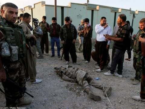 October 22, 2016 - Kirkuk, Iraq - Iraqi Kurdish security forces look at the body of an Islamic State militant tha's being dragged behind a truck through the city of Kirkuk. ISIS executed 284 men and boys as coalition forces closed in on Mosul, an Iraqi intelligence source said. Those killed on Thursday and Friday had been used as human shields against attacks that are forcing ISIS out of the southern sections of Mosul. (Credit Image: © Ako Rasheed/Reuters via ZUMA Press)