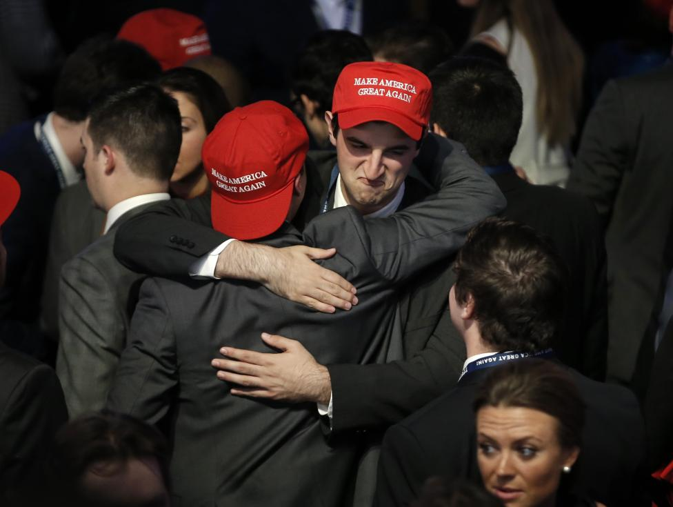 Trump supporters embrace as they watch election returns come in at Republican U.S. presidential nominee Donald Trump's election night rally in New York