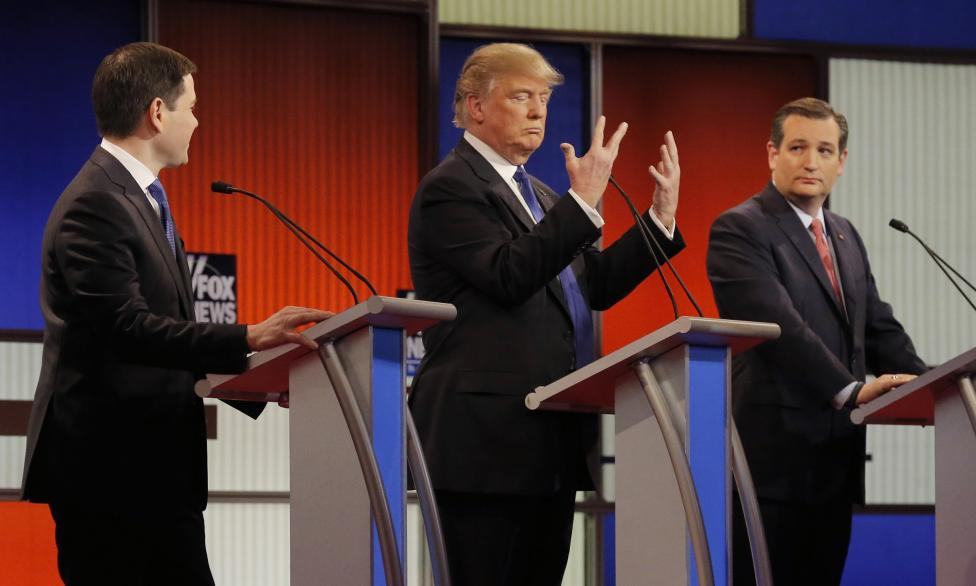 Republican U.S. presidential candidate Trump shows off the size of his hands as rivals Rubio and Cruz look on at the start of the U.S. Republican presidential candidates debate in Detroit