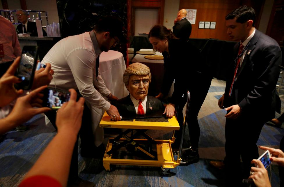 A cake in the form of Republican U.S. presidential nominee Donald Trump is brought into the hotel where his election night rally will be held
