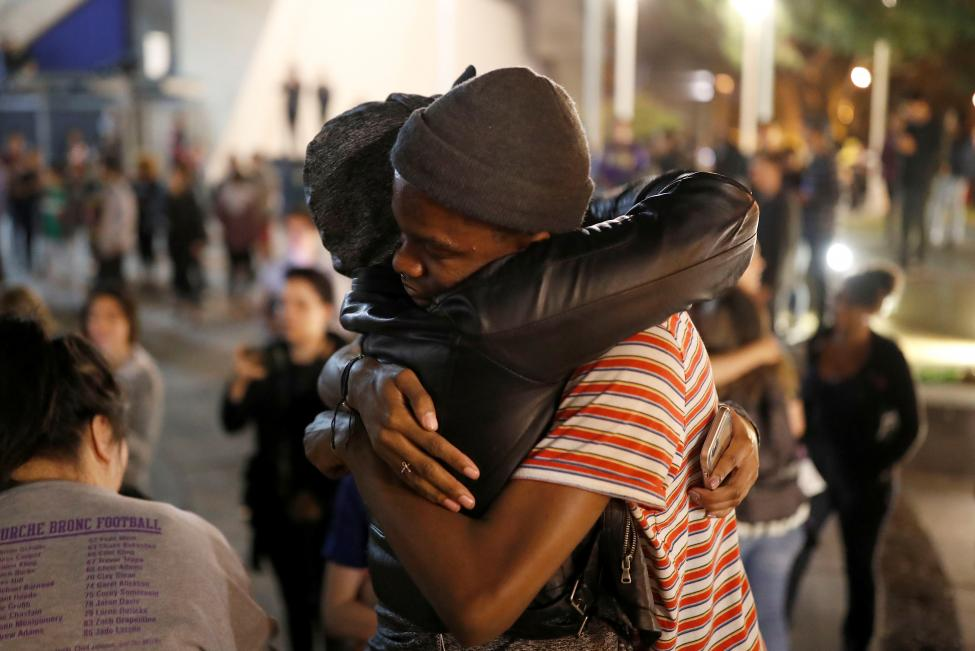 Students embrace each other during a demonstration at San Francisco State University in San Francisco, California, U.S. following the election of Donald Trump as President of the United States