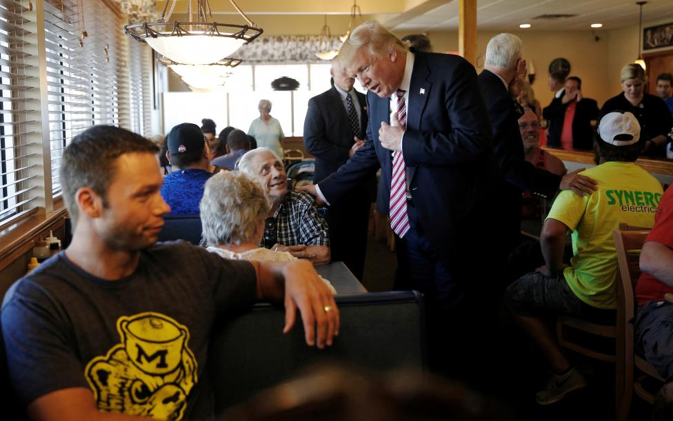Republican presidential nominee Donald Trump greets diners during a campaign stop at Goody's Family Restaurant in Brook Park