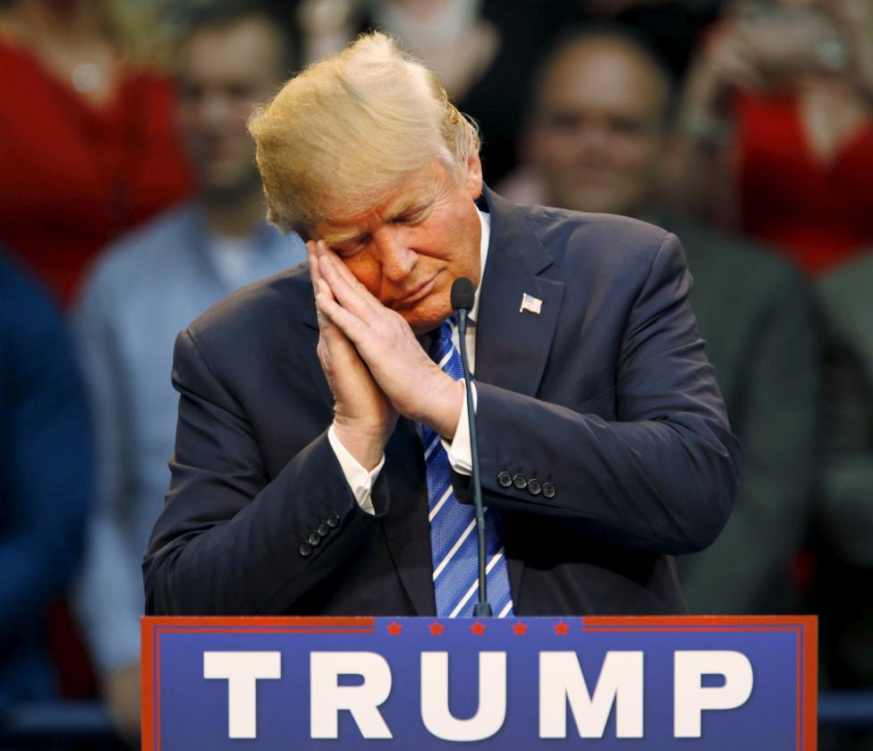 U.S. Republican presidential candidate Donald Trump gestures as if he is sleeping while talking about his opponent Jeb Bush during a Trump for President campaign rally in Raleigh, North Carolina