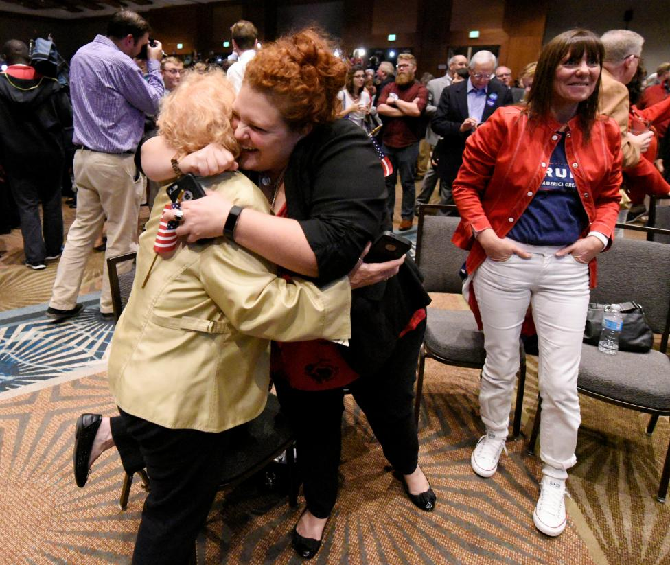 Supporters of U.S. Republican candidate Donald Trump celebrate after the networks called their candidate's victory in the state of North Carolina, at Republican Governor Pat McCrory's election-night party in Raleigh, North Carolina