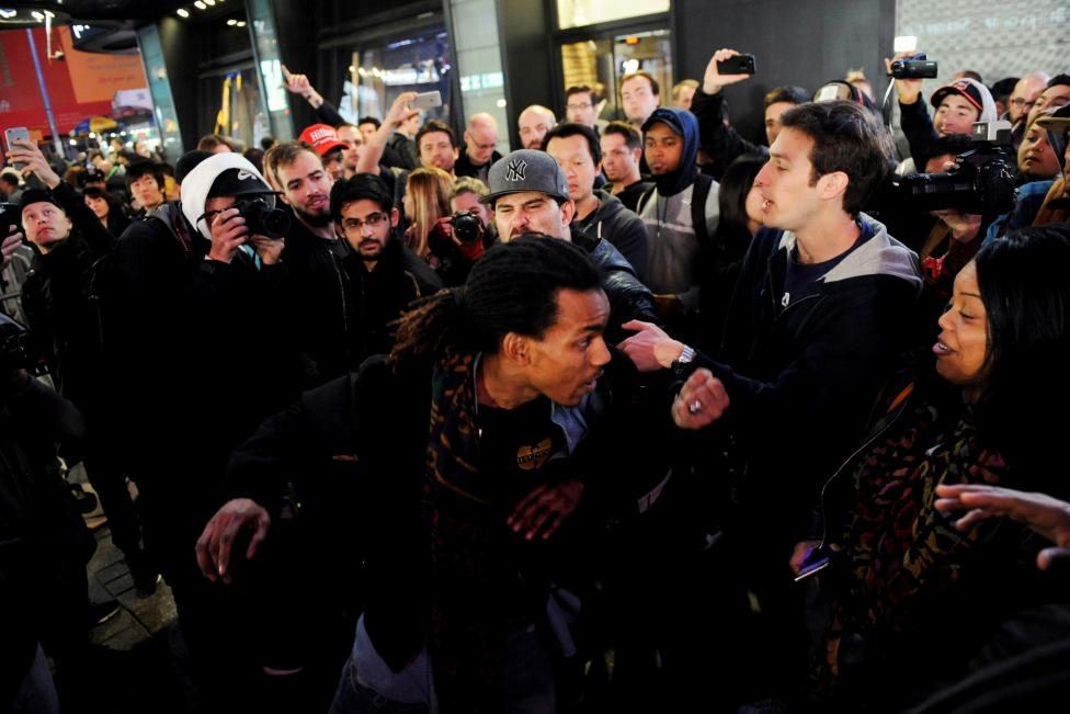 A supporter of U.S. president-elect Donald Trump is shoved by a supporter of former U.S. presidential nominee Hillary Clinton after Trump was declared the winner in Times Square in New York