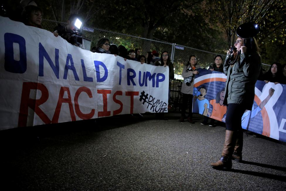 Hispanic demonstrators protest in front of the White House as the polls are counted in the U.S. presidential election in Washington