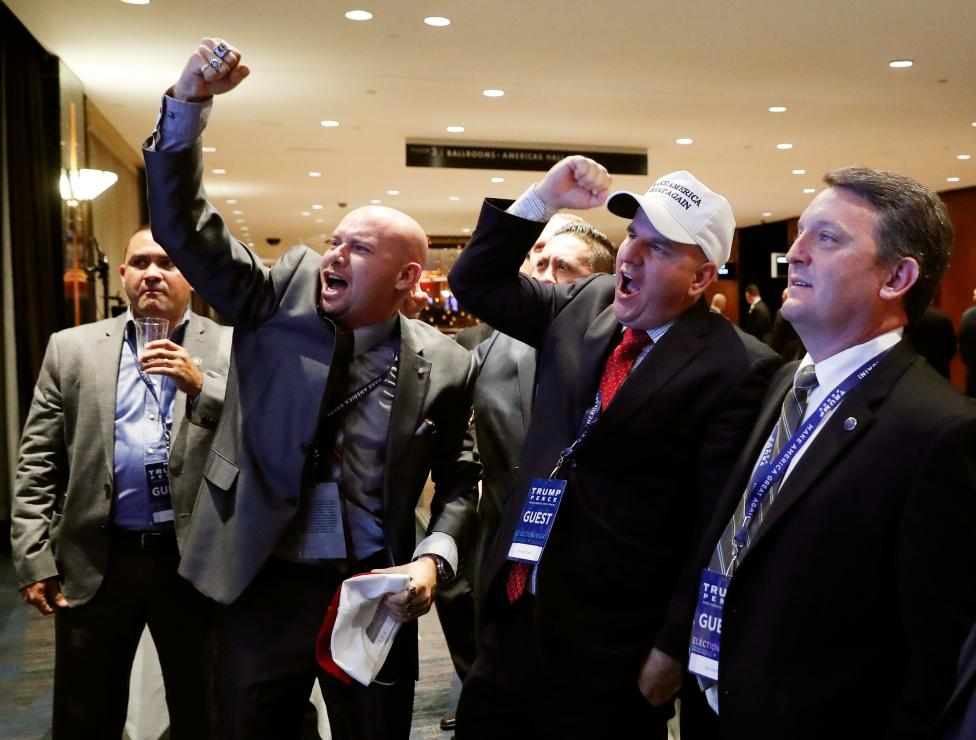 Members of the National Border Patrol Council celebrate as election results from North Carolina come in ahead of the rally for Republican U.S. presidential nominee Donald Trump in New York City