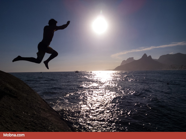Rian Azeredi Jumps from the rocks in between Ipanema and Copacab
