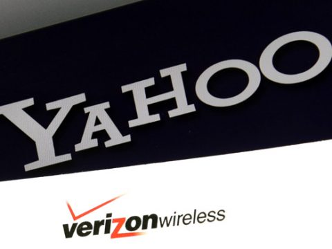 Logos are seen on a laptop, Monday, July 25, 2016, in North Andover, Mass. Verizon is buying Yahoo for $4.83 billion, marking the end of an era for a company that once defined the internet. It is the second time in as many years that Verizon has snapped up the remnants of a fallen internet star as it broadens its digital reach. (AP Photo/Elise Amendola)